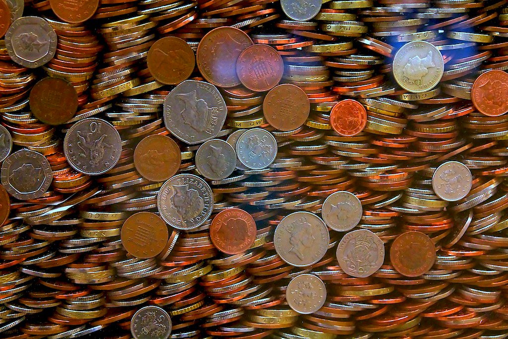 Money and coins piled up